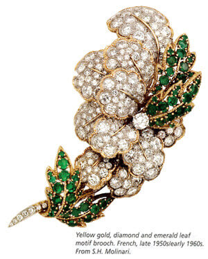 Yellow gold, diamond and emerald leaf motif brooch. French, late 1950s / early 1960s.