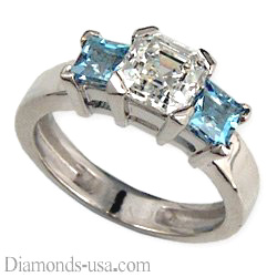 Two aquamarine side stones engagement ring
