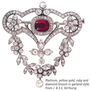 Platinum, yellow gold, ruby and diamond brooch garland style.