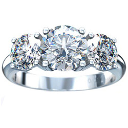 Round cut three stone engagement ring