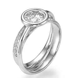 Anniversary or Engagement ring, low profile bezel set. 0.45Cts side diamonds
