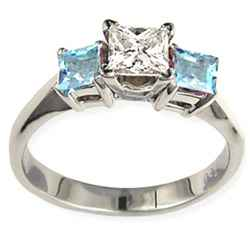 Engagement ring with Princess side Aquamarines