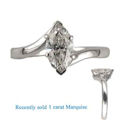 Low profile embracing ring for Marquise diamonds