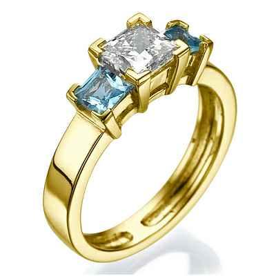 Two aquamarine side stones engagement ring