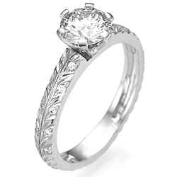 Leaf motif with diamonds engagement ring