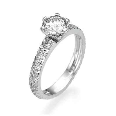 Adorno de hoja con anillo de compromiso de diamantes