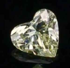 Picture of 0.5 Carats, Heart Diamond with Very Good Cut, Fancy Yellow Color, VS1 Clarity and Certified By EGL