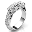 Picture of Three stones diamond ring encrusted with diamonds
