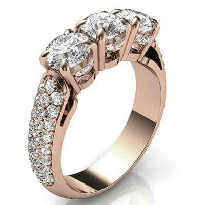 Three stones diamond ring encrusted with diamonds