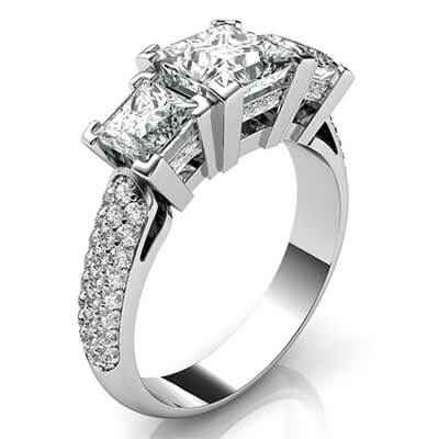 Three Princess diamonds engagement ring encrusted with diamonds