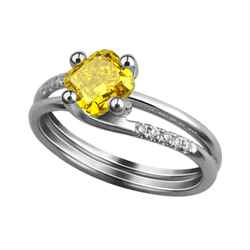 Fancy vivid yellow colored diamond in a ring