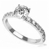 Engagement ring with open pave set accent diamonds