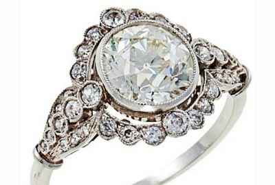 vintage engagement ring bezel set with diamonds halo