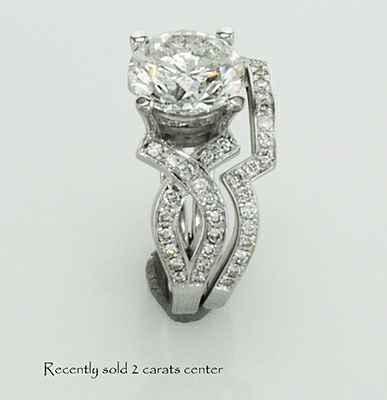 Bowtie engagement ring 0.25CTW side diamonds