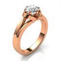Foto El anillo de compromiso de oro rosa vintage del solitario nido de