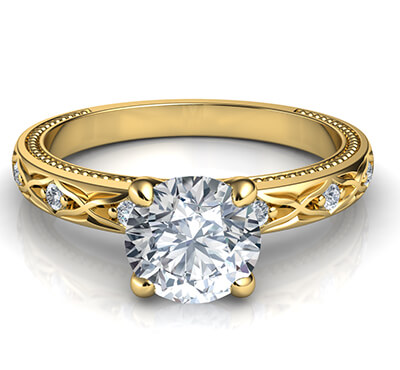 Leaf motif vintage style engagement ring with side diamonds