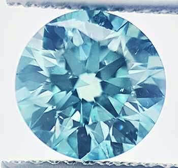 Picture of 1.54 Carats, Round Diamond with Ideal Cut, Blue color enhanced, SI1 NOT enhanced, Certified by IGL