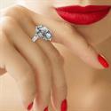 Foto Anillo de compromiso Art Deco con diamantes laterales de 0,42 quilates. de