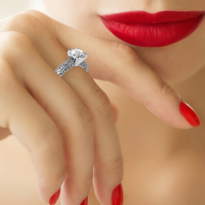 Filigree Designers model prongs head Solitaire engagement ring