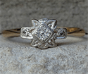 Picture of Dainty 1930's Art Deco Engagement ring set with natural center diamond 0.10 carat