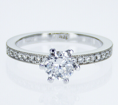 Pave set side diamonds Novo engagement ring