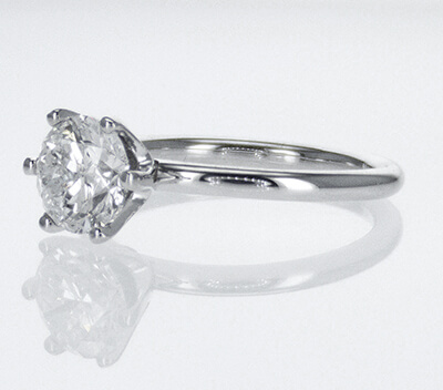 Solid tube engagement ring with 6 prongs Tiffany style head