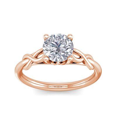 Anillo de compromiso con solitario en oro rosa con motivo de hoja de oro,