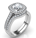 Picture of Low profile bezel halo bridal set for all shapes. Set with 1/2 carat side diiamonds