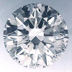 Foto 1.18 quilates, diamante redondo con corte ideal, color I, claridad SI1 y certificado por IGL de