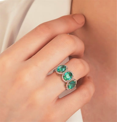 Three Emerald Ovals ring with side diamonds