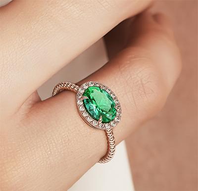 1 1/4 carat Oval Emerald and 1/5 carat diamonds ring