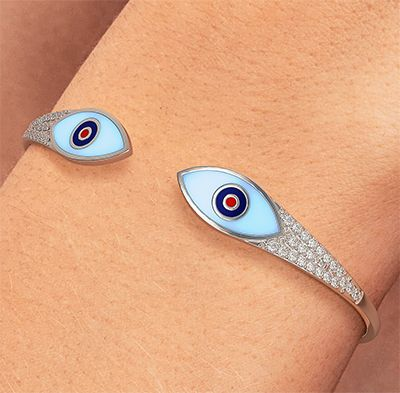 Solid Gold bangle with 0.65 carat diamonds and Enamel eyes