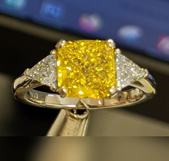 Cushion vivid yellow diamond with side Triangles