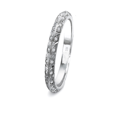Hand engraved leaf motif matching wedding band, set with 24 diamonds