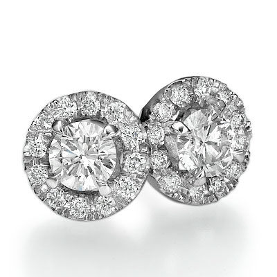 Halo earring studs with 0.31 carats surrounding round diamonds