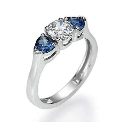 Engagement ring with two Heart Blue Sapphires