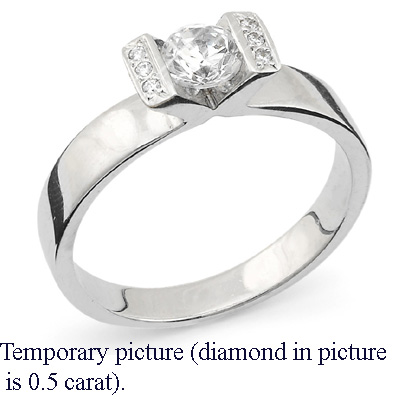 0.91 Carats, Round, Engagement ring with side stones settings